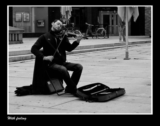 He is a not so typical street performer. He was REALLY into himself playing. So much so that it made me take this picture.